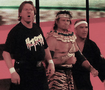 Jimmy Snuka (center)